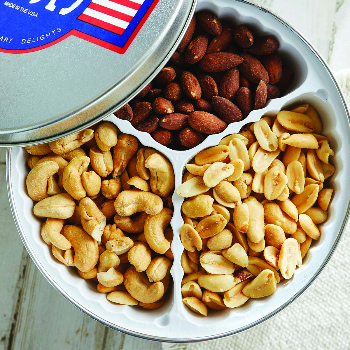 - Roasted and Salted Nut Sampler Tin